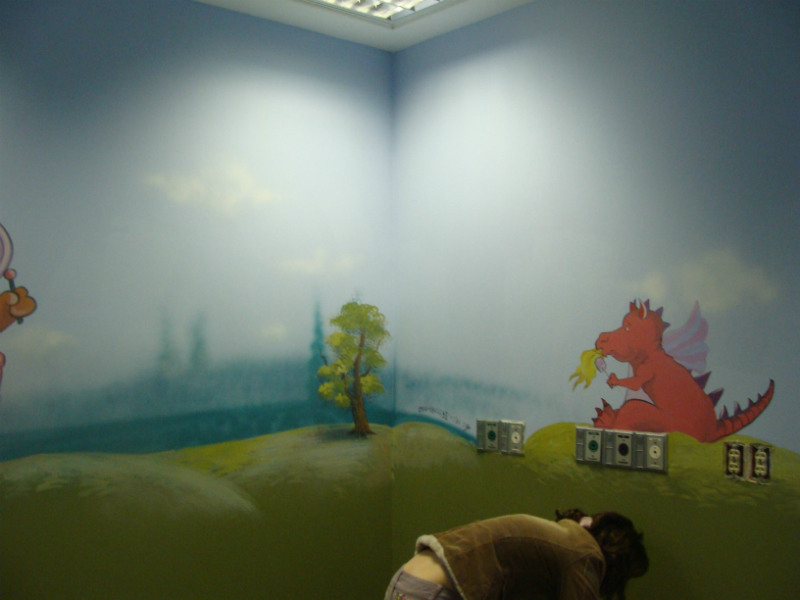 a mural painted on a low wall