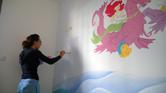 ציורי קיר של בת הים איפשהו בהתחלה
