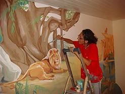 ציור קיר לנוער של נוף אפריקני ואריה
