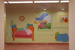ציור קיר של דמויות מאגדת ילדים מאשה והדוב