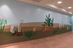 ציור קיר של זאב, גופר, נמר, אלפקות וקואלה